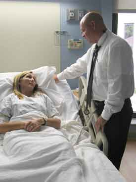 Doctor With Patient At Inpatient Care Facility
