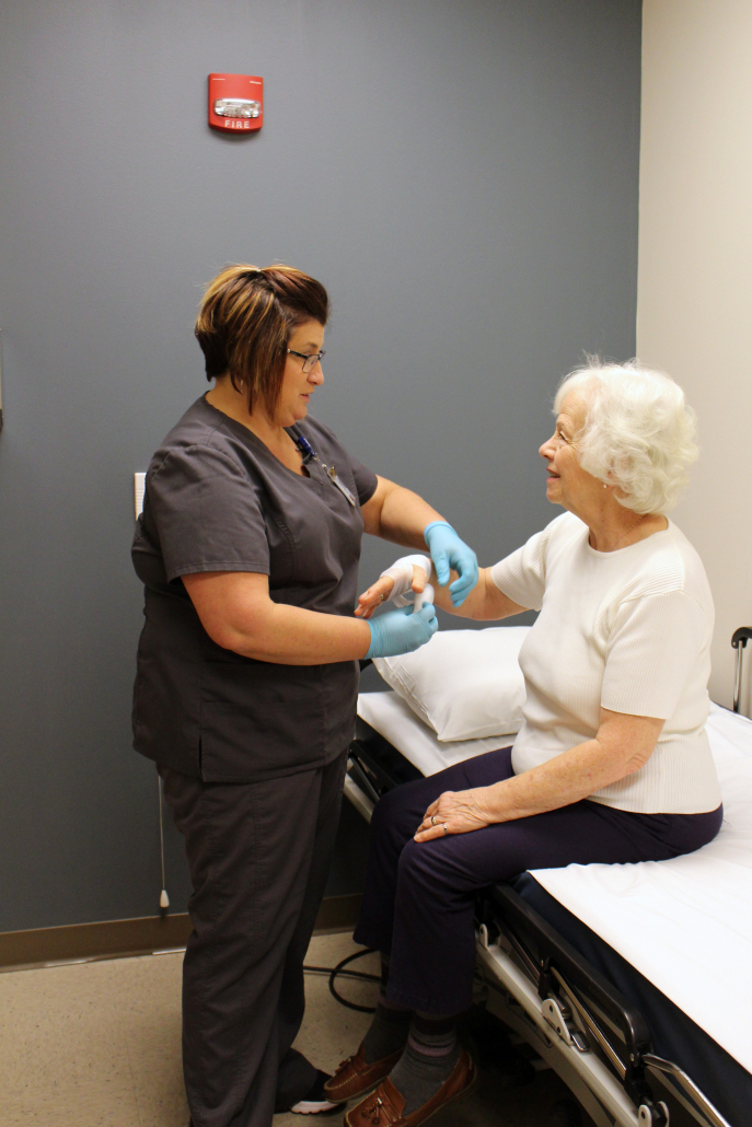 Physician Tending To Patient In Fulton County Wound Care Center