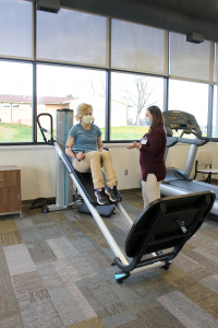 Patient Using Exercise Equipment In Fulton County Rehab Clinic